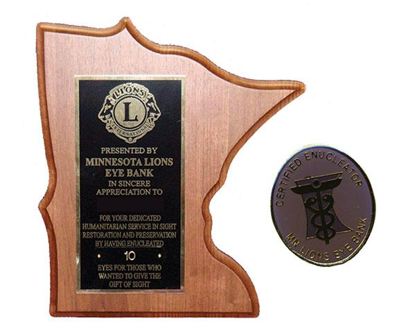 Plaque and pin for volunteer enucleators